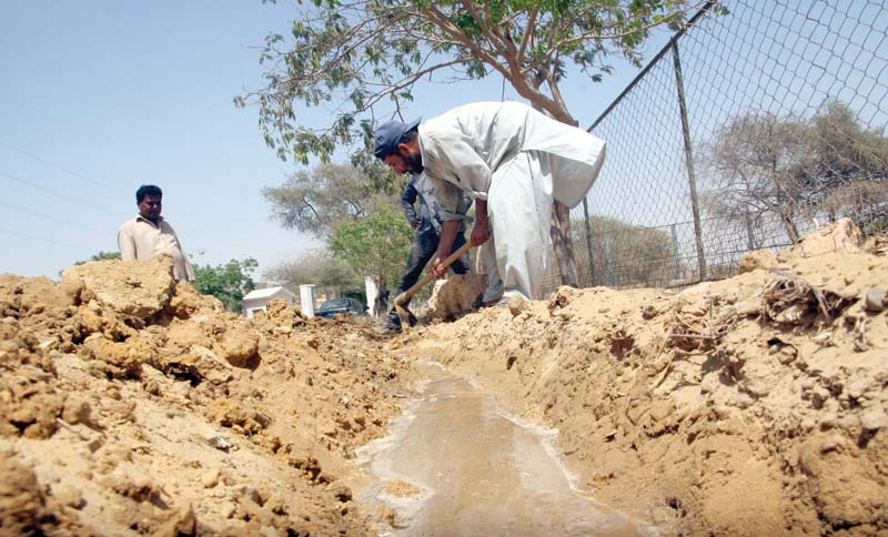 karachi zoo is home to over 900 animals all of whom are at risk due to the heatwave that claimed the lives of thousands of animals and humans last year bottom workers dig the canal laid down to supply water to cages photos athar khan express