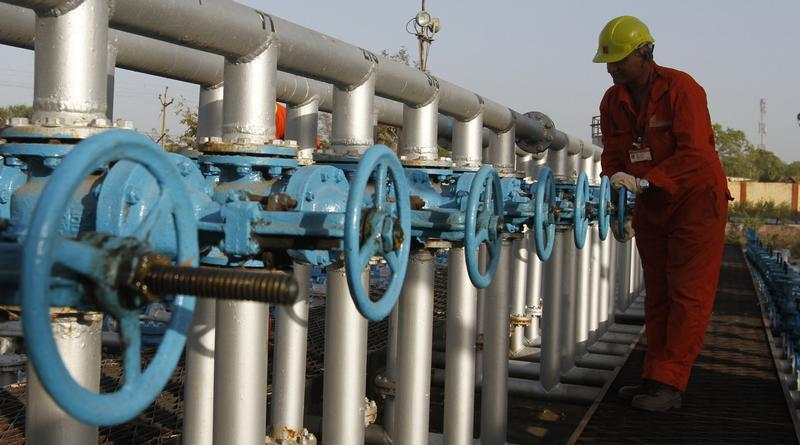amount kept lower against outgoing year s initial target due to sharp fall in crude prices photo reuters