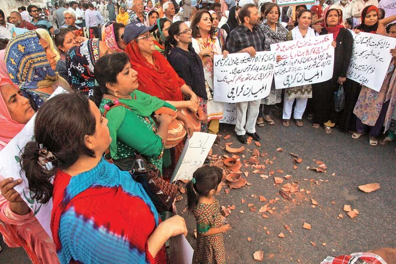 the protest staged by mqm continued late into the evening with workers including women smashing clay pots onto the road as a sign of protest photo athar khan express