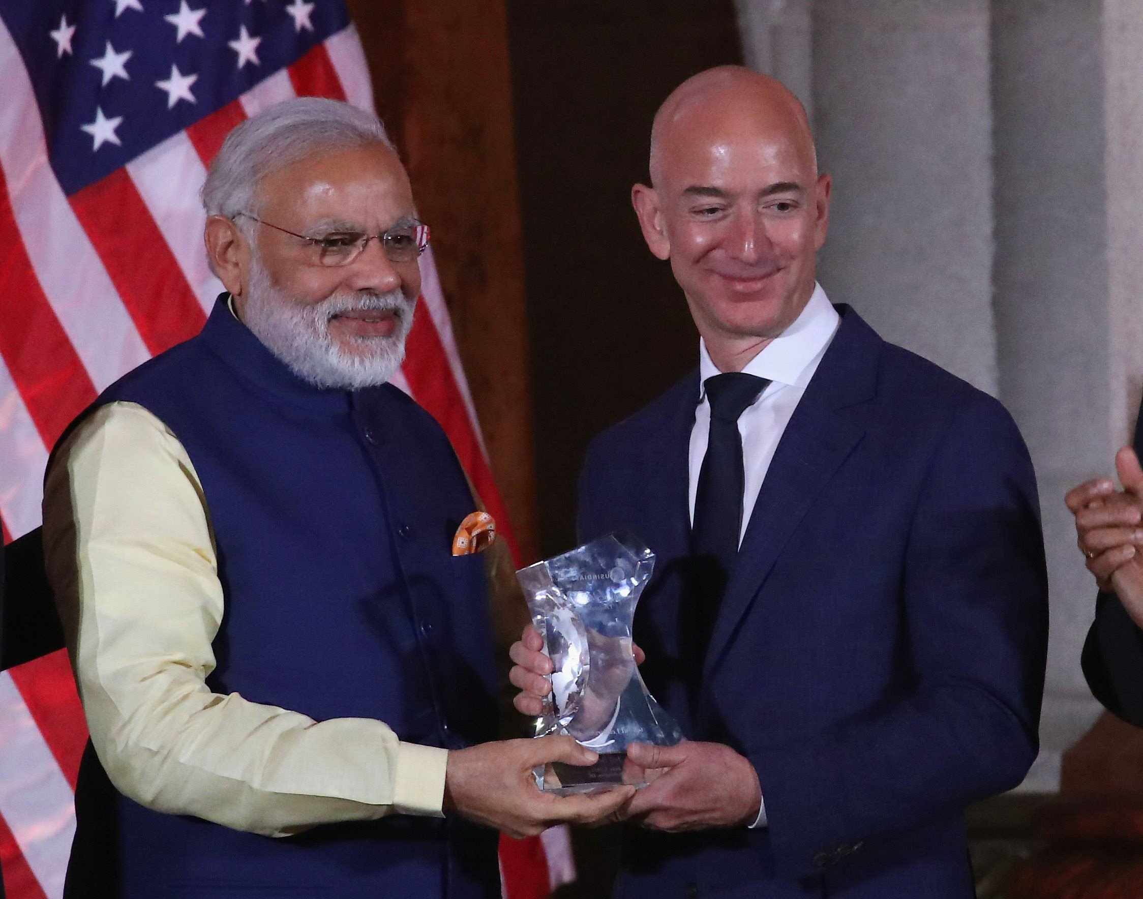 Jeff Bezos, (R), CEO of Amazon, is presented with the 2016 USIBC Global Leadership Award by Indian Prime Minister Narendra Modi during the 41st Annual Leadership Summit at the Mellen Auditorium, June 7, 2016 in Washington, DC. PHOTO: AFP