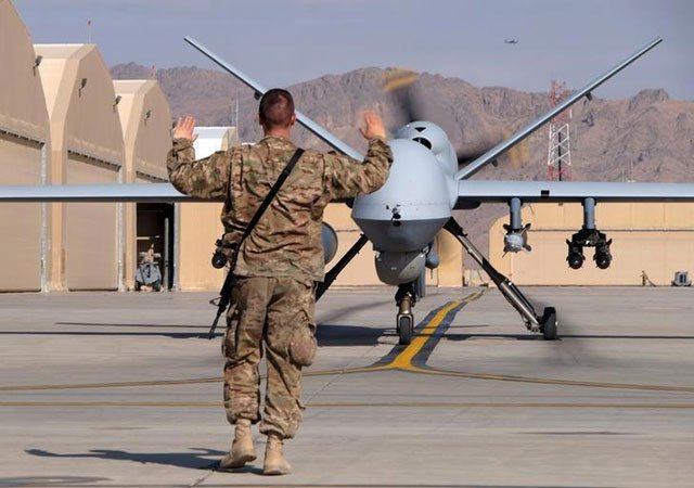 a us airman guides a us air force mq 9 reaper drone as it taxis to the runway at kandahar airfield afghanistan march 9 2016 photo reuters