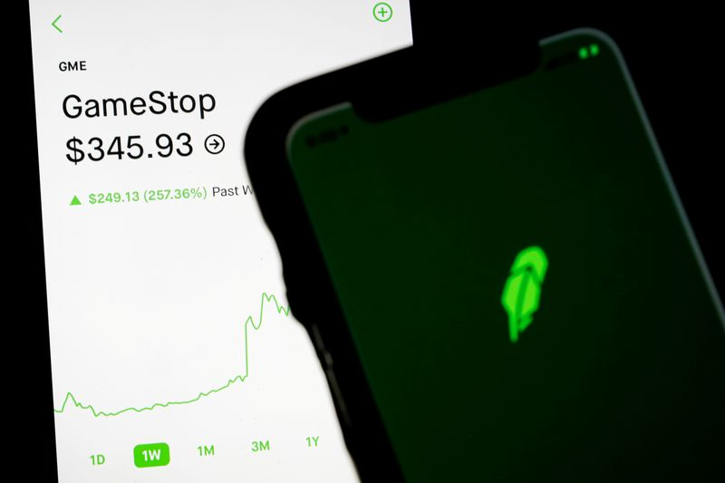 trading information for gamestop is displayed on the robinhood app as another screen displays the robinhood logo photo reuters