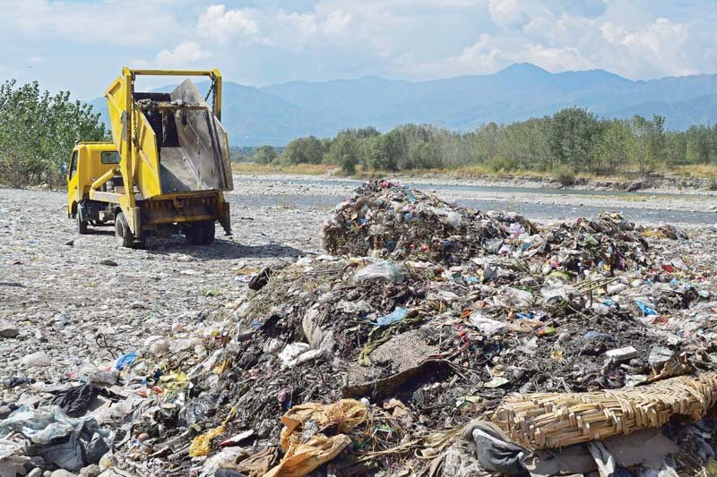 dumping ground swat river polluted by irresponsible waste disposal