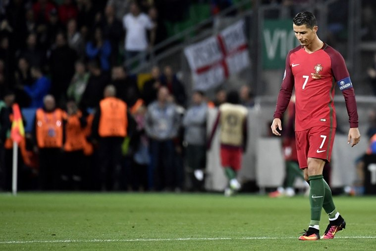 portugal 039 s forward cristiano ronaldo walks on the pitch during the euro 2016 group f football match between portugal and iceland at the geoffroy guichard stadium in saint etienne on june 14 2016 photo afp