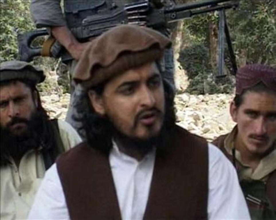 Late TTP chief Hakimullah Mehsud (C) sits with other millitants in South Waziristan. PHOTO: REUTERS