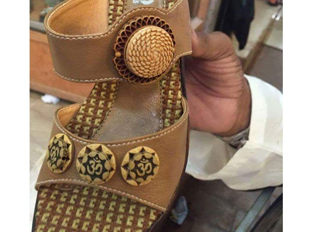 picture shows the sandal which is being sold at shops in tando adam inscribed with hindu sacred word quot om quot photo pakistan hindu council