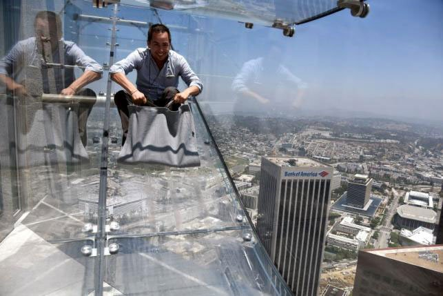 A member of the media rides the Skyslide from the 70th to 69th floor of the US Bank Tower which is attached to the OUE Skyspace LA observation deck in downtown Los Angeles, California, US, June 23, 2016. PHOTO: REUTERS