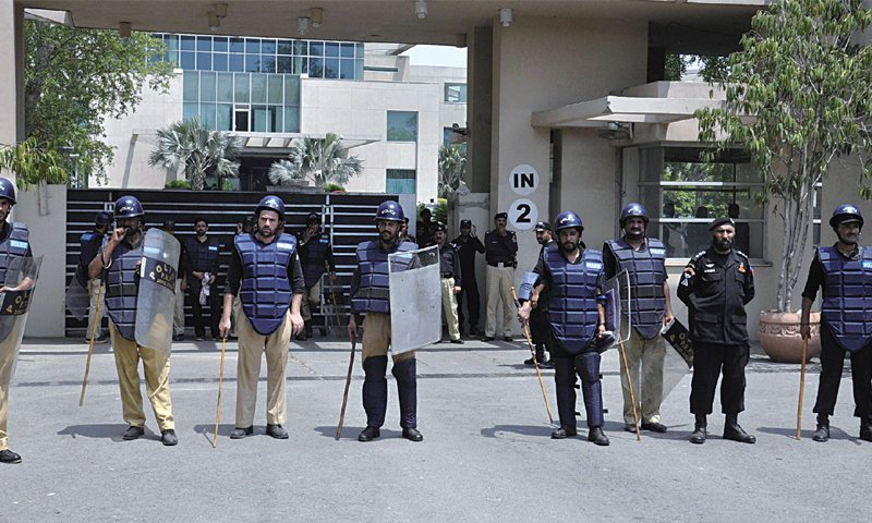 railway police stand guard outside the royal palm golf and country club which was taken over by pr on friday photo online