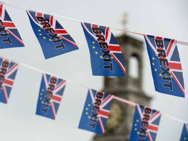 This file photo taken on June 13, 2016 shows Pro-Brexit depicting a Union flag merged with the EU flag, fly from a fishing boat moored in Ramsgate, south-est England. PHOTO: AFP