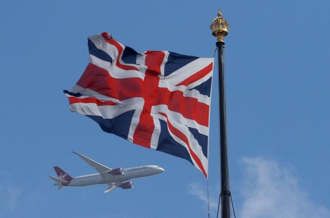 A Virgin Atlantic passenger jet flies past the Union Flag above the Houses of Parliament in Westminster, in central London, Britain. PHOTO: REUTERS