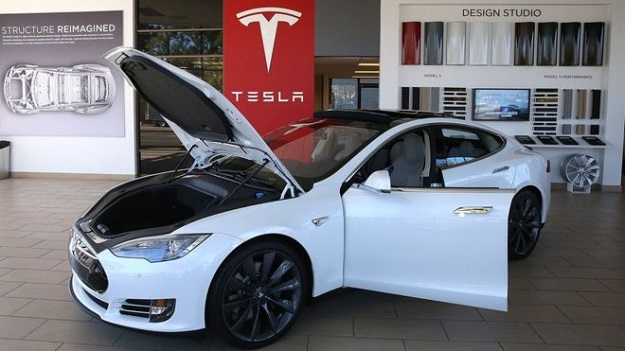 tesla reaches 2 6 bn deal to buy solarcity