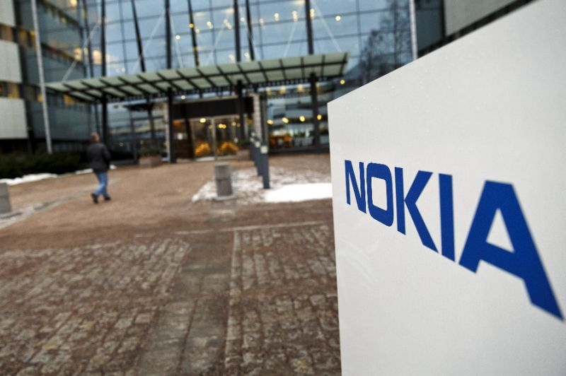 nokia to accelerate savings after reporting net loss of 741m