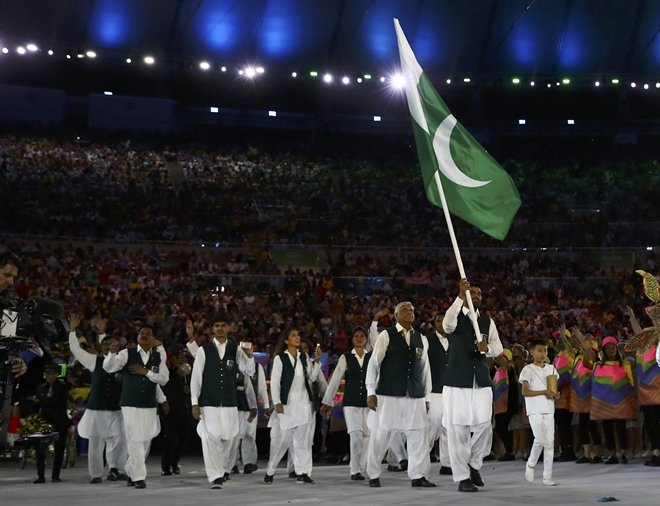 Flagbearer Ghulam Mustafa Bashir (PAK) of Pakistan leads his contingent during the opening ceremony.  PHOTO: REUTERS
