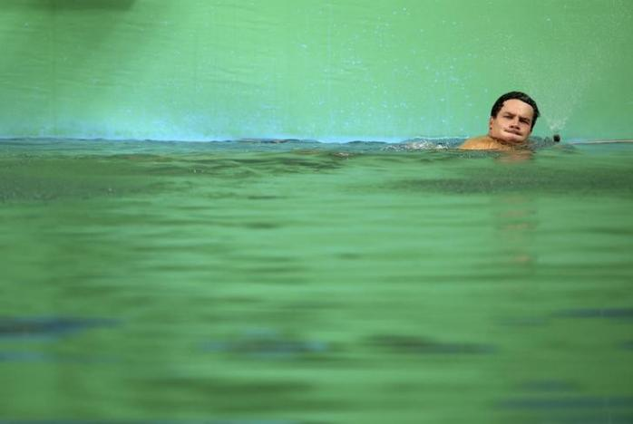 2016 Rio Olympics - Diving - Men's 3m Springboard - Maria Lenk Aquatics Centre - Maria Lenk Aquatics Centre - Rio de Janeiro, Brazil - 13/08/2016. Patrick Hausding (GER) of Germany swims in the green coloured water of the diving pool at the Maria Lenk Aquatics Centre. PHOTO: REUTERS