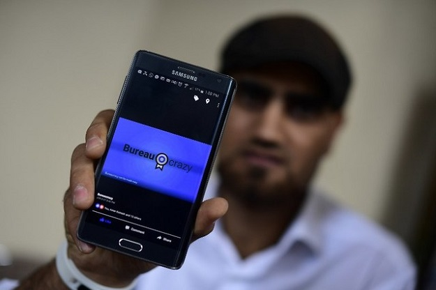 Omar Alshafai holds his mobile phone for a picture. PHOTO: AFP