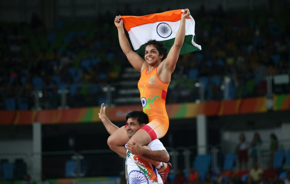 Sakshi Malik celebrates with her team member after winning the bronze medal. PHOTO: REUTERS