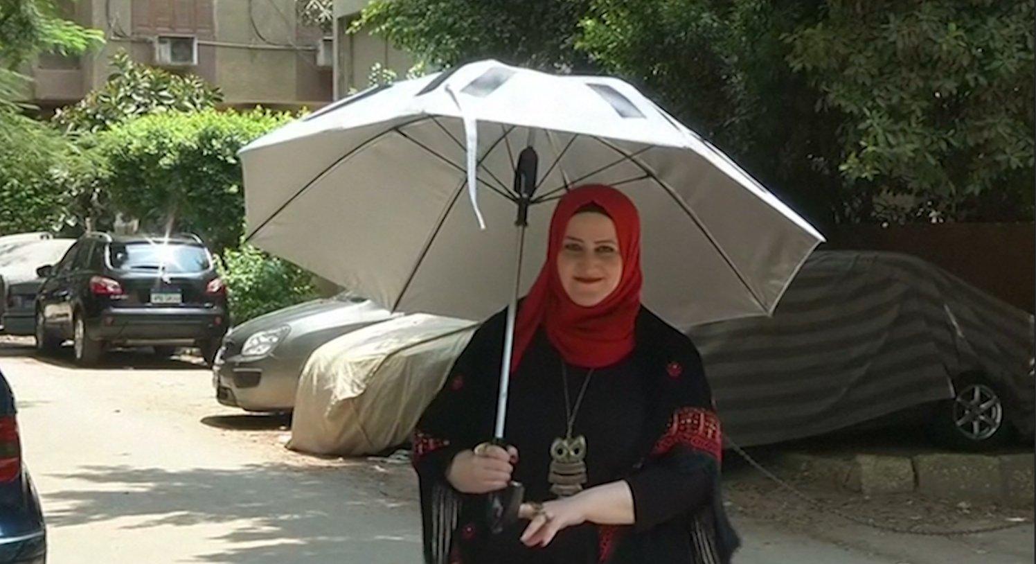solar powered umbrella offers pilgrims relief