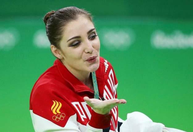 Aliya Mustafina (RUS) of Russia celebrates winning the gold. PHOTO: REUTERS