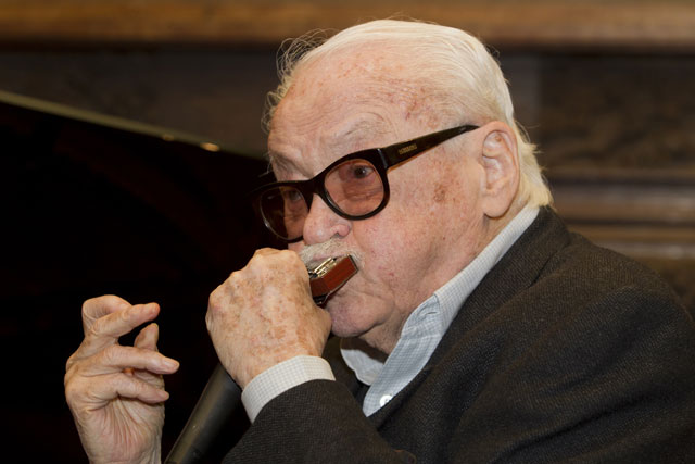 this file photo taken on february 29 2012 shows musician toots thielemans playing harmonica at a press conference for the toots90 to present the events organised for the 90th anniversary of the artist in la hulpe belgium photo afp