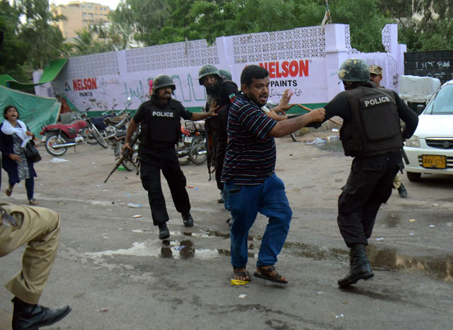 an mqm activist clashs with police personnel in karachi on monday augusut 22 2016 photo express