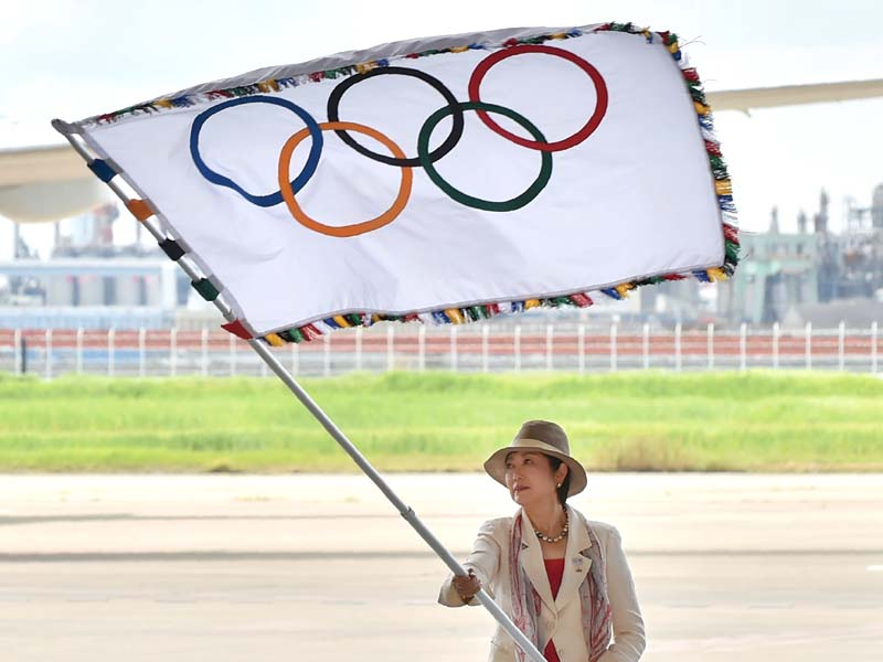2020 games rio passes olympic flag to tokyo