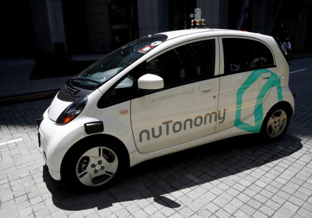 a nutonomy self driving taxi drives on the road in its public trial in singapore august 25 2016 photo reuters