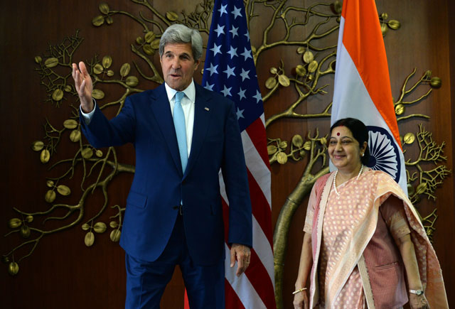 Indian Minister of External Affairs Sushma Swaraj (R) and US Secretary of State John Kerry speak prior to a meeting in New Delhi on August 30, 2016. PHOTO: AFP