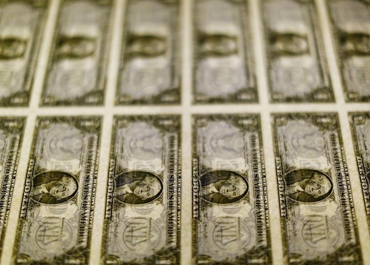 united states one dollar bills are seen on a light table at the bureau of engraving and printing in washington november 14 2014 photo reuters