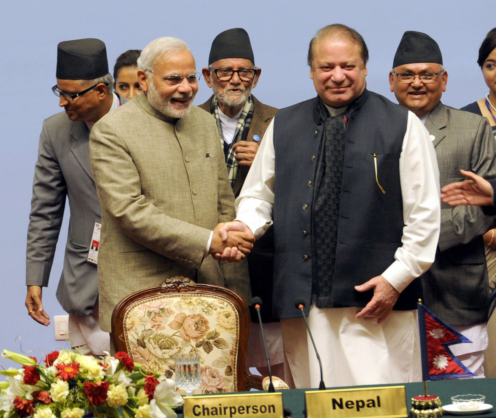 In this handout photograph received from the Indian Press Information Bureau (PIB) on November 27, 2014, Indian Prime Minister Narendra Modi (L) shakes hands with Prime Minister Nawaz Sharif at the 18th SAARC Summit in the Nepalese capital Kathmandu.  PHOTO: AFP