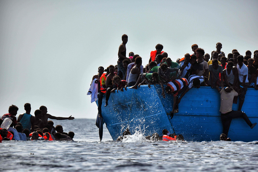 Migrants wait to be rescued by members of Proactiva Open Arms NGO in the Mediterranean Sea, some 12 nautical miles north of Libya, on October 4, 2016. PHOTO: AFP