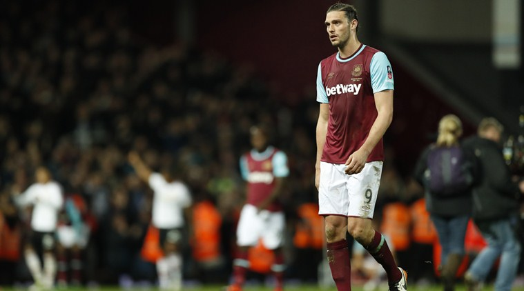 andy carroll threatened by armed robbers