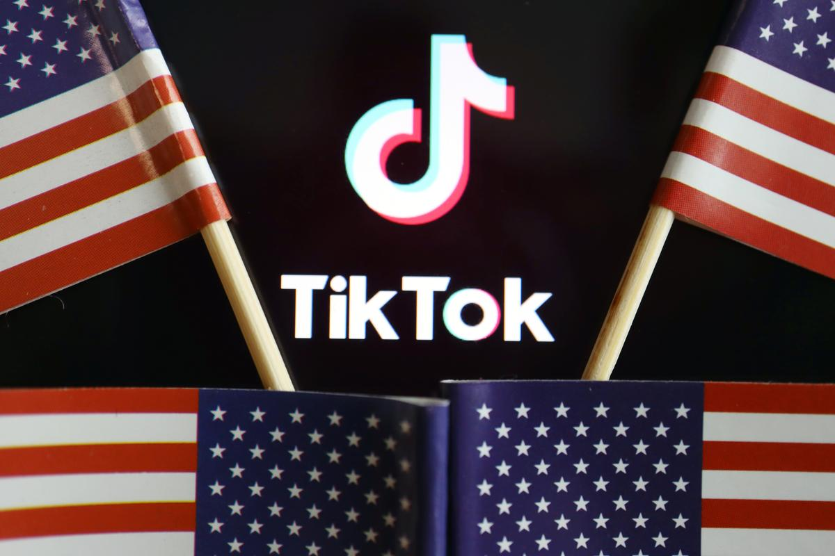 us flags are seen near a tiktok logo in this illustration picture taken july 16 2020 photo reuters