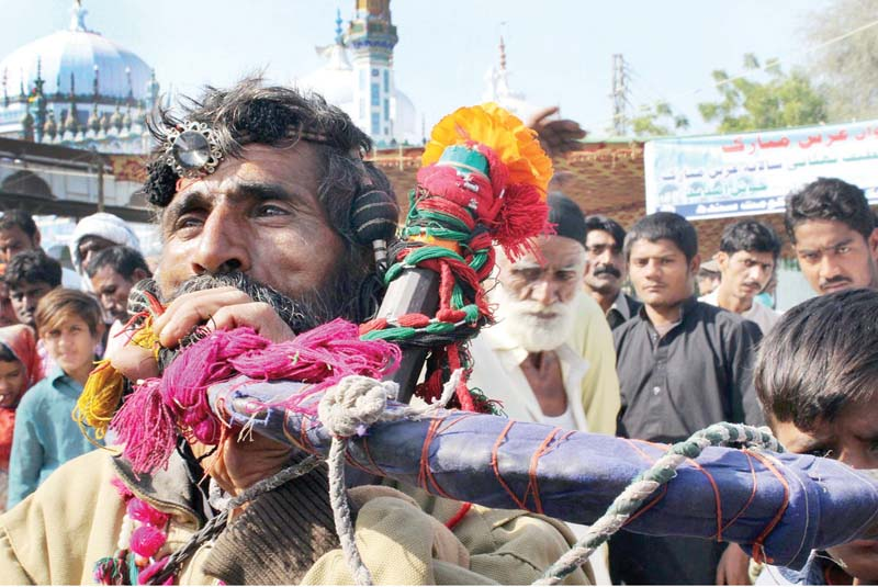 celebrating the sufi saint devotees throng bhit shah undeterred by security threats