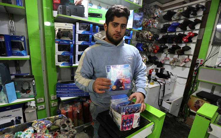 a vendor displays a playstation 4 game at his shop in the central market of iran s capital tehran on january 24 2021 photo afp
