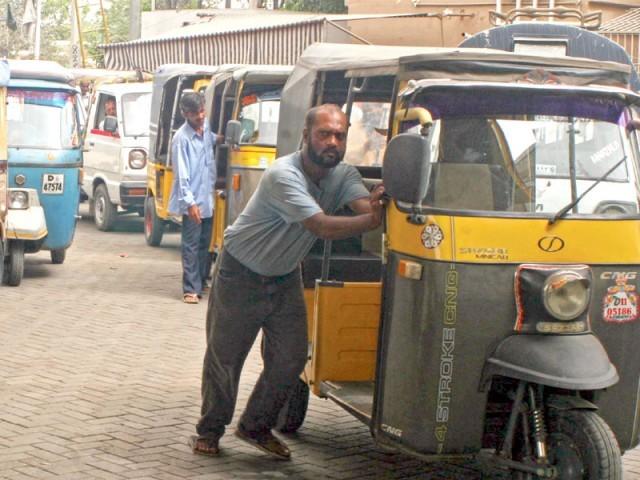 a rickshaw driver in karachi awaits his turn at a cng station in karachi photo athar khan express