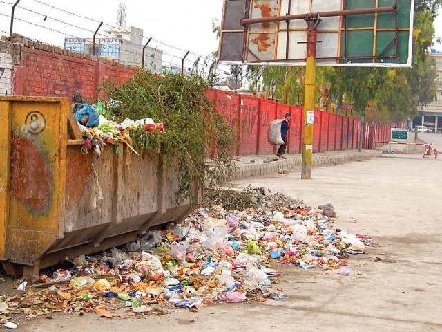 for the residents of karachi it is more than a garbage dump it is a forever looming health hazard photo file
