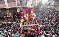 mourners carry a tazia during the main chehlum procession on monday photo abid nawaz express