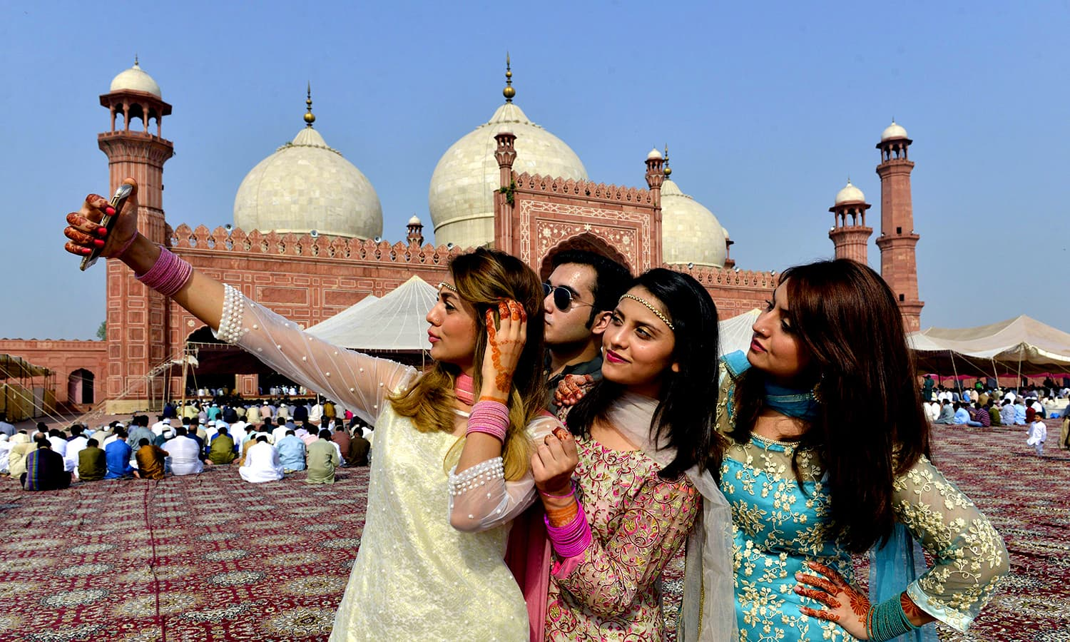 Women pose for selfie after attending Eidul Azha prayers in Lahore on September 13, 2016.PHOTO: AFP