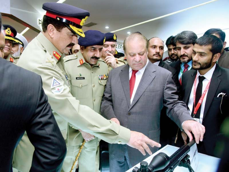 pm nawaz and gen raheel inspect a pof made sniper rifle on display at ideas 2016 photo inp