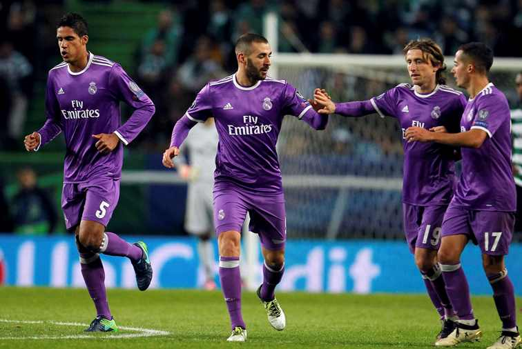 late benzema strike seals real s victory on ronaldo s homecoming