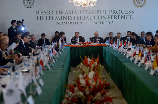 Prime Minister's National Security Adviser Sartaj Aziz (C-R), Afghan Foreign Minister Salahuddin Rabbani (C-L), and other countries' delegates attend the first day of the Heart of Asia conference in Islamabad on December 9, 2015. PHOTO: AFP