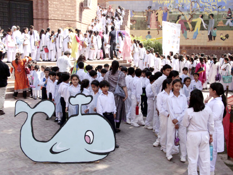 School children attending the festival queue up to watch a show. PHOTO: SHAFIQ MALIK/EXPRESS