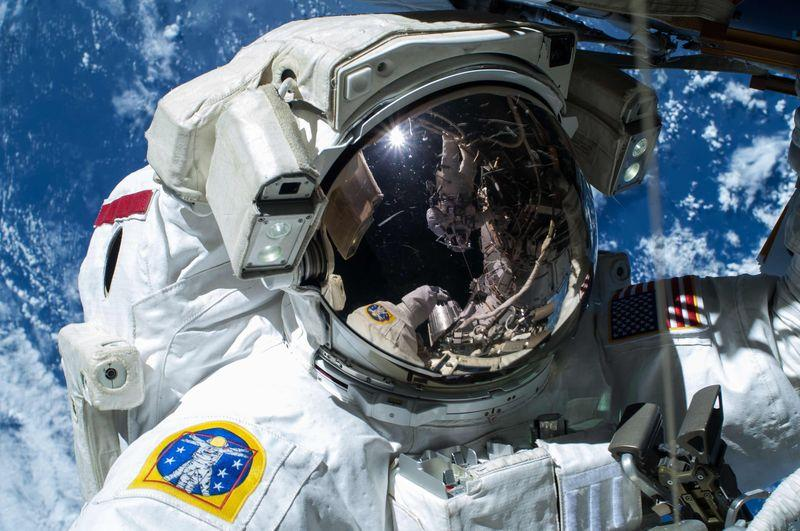 nasa astronaut barry quot butch quot wilmore commander of expedition 42 is caught by the camera as the earth 039 s surface passes by in the background on the international space station in this handout photo taken february 21 2015 provided by nasa reuters nasa handout