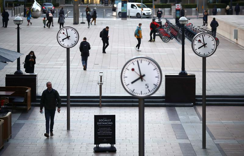 people walk during the morning rush hour in the canary wharf amid the outbreak of the coronavirus disease covid 19 in london britain photo reuters