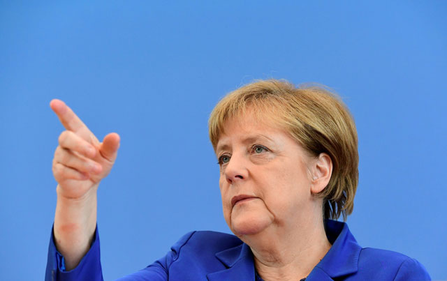 German Chancellor Angela Merkel gestures during a press conference in Berlin. PHOTO: REUTERS