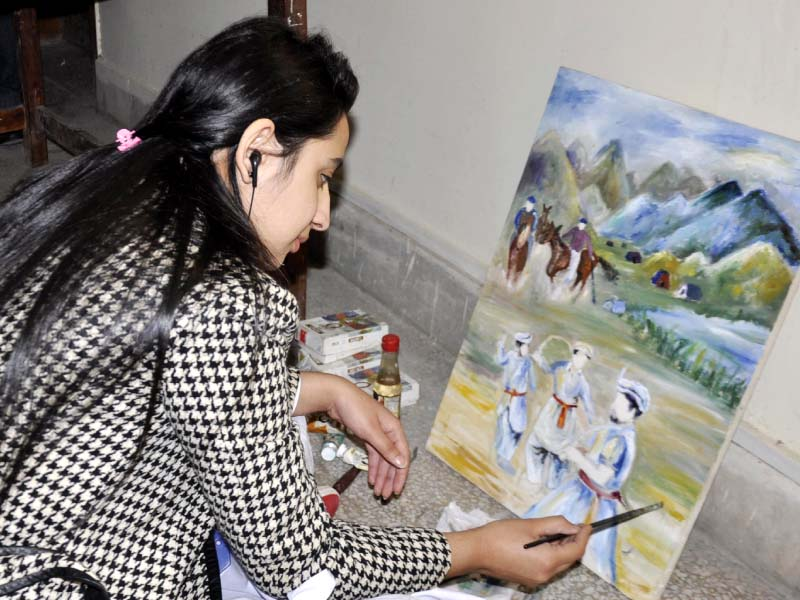 sixth pakistan mountain festival girls paint mountain culture in a live competition