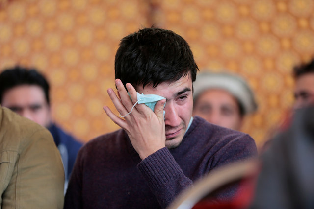Relatives grieve as they wait for word on the collection of the remains of victims of the Pakistan International Airlines (PIA) plane crash at PIMS hospital in Islamabad. PHOTO: REUTERS