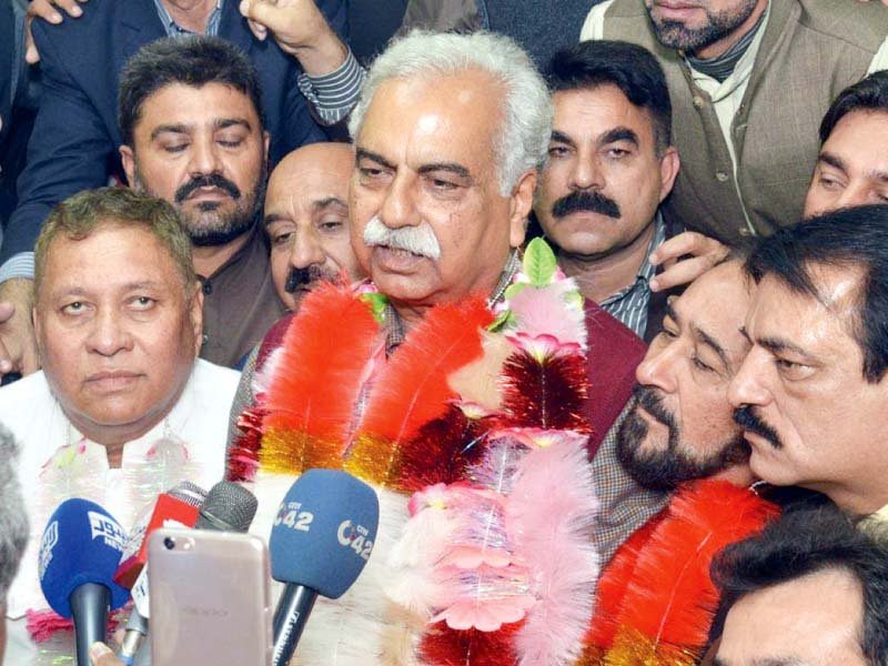 col retd mubashar javaid speaks to reporters after his election photo express