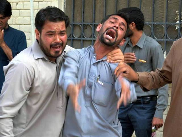 bystanders react at the site after a bomb explosion at civil hospital premises in quetta photo express tribune