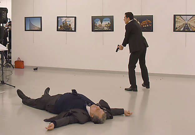 terrorist act turkish policeman assassinates russian ambassador